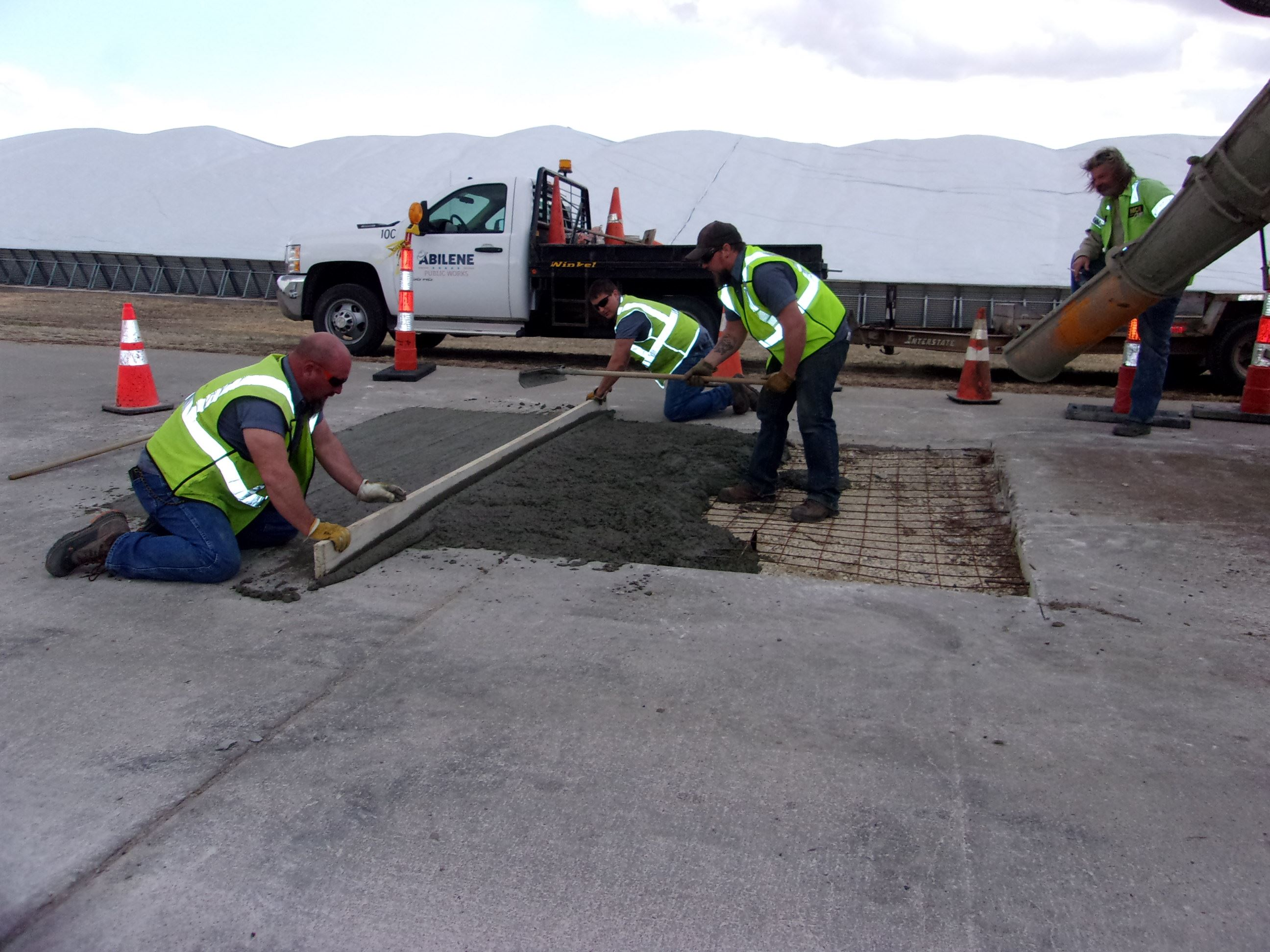 Street Crew Smoothing out Concrete