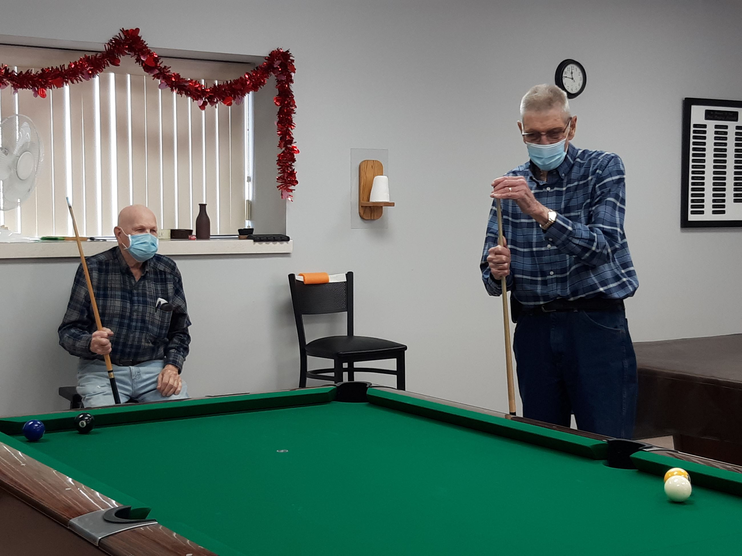 2 guys playing pool